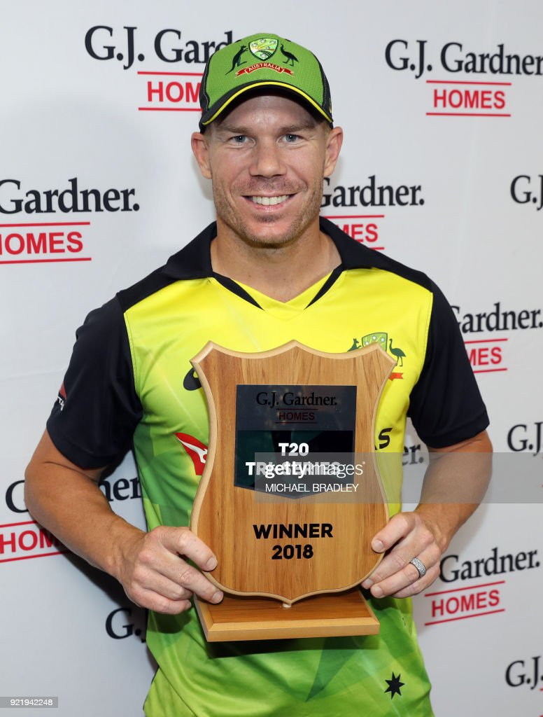 Australia's cricketer David Warner celebrates after winning the final Twenty20 Tri Series international cricket match between New Zealand and Australia at Eden Park in Auckland on February 21, 2018. /