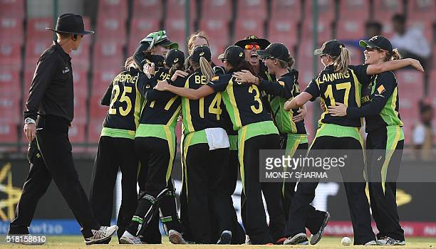Australia's cricketers celebrate after victory in the World T20 women's cricket tournament semifinal match between England and Australia at The Feroz...