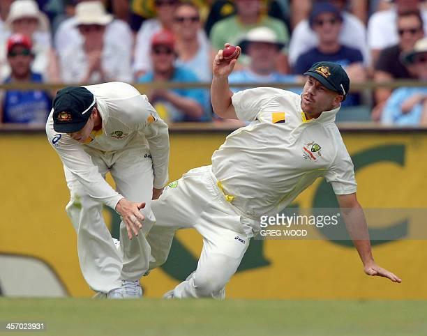 Australia's cricketers Steven Smith and David Warner get in each others way while fielding on the fourth day of the third Ashes cricket Test match...