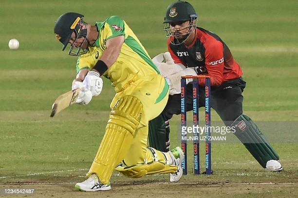Australia's Dan Christian plays a shot and Bangladesh's Quazi Nurul Sohan looks on during the fourth Twenty20 international cricket match between...