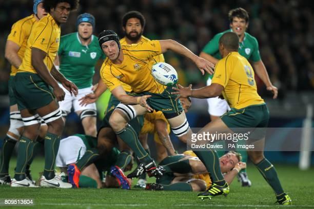 Australia's Dan Vickerman passes the ball off to Will Genia
