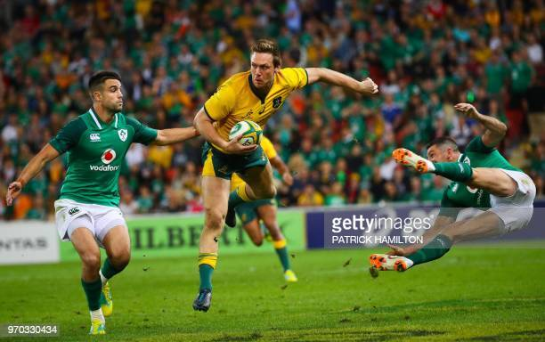 Australia's Dane Haylett-Petty beats the tackles of Ireland's Johnny Sexton and Rob Kearney during the first rugby Test between Australia and Ireland...