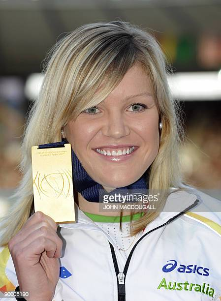 Australia's Dani Samuels celebrates her gold medal on the podium of the women's discus throw medal ceremony of the 2009 IAAF Athletics World...