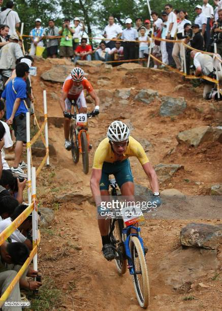 Australia's Daniel McConnell is seen in action during the men's cross country mountain bike race at the Laoshan Cycling venue during the 2008 Beijing...