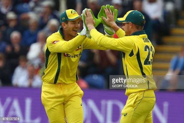 Australia's DArcy Short celebrates with Australia's captain Tim Paine after catching England's captain Joe Root for 22 during play in the 2nd One Day...