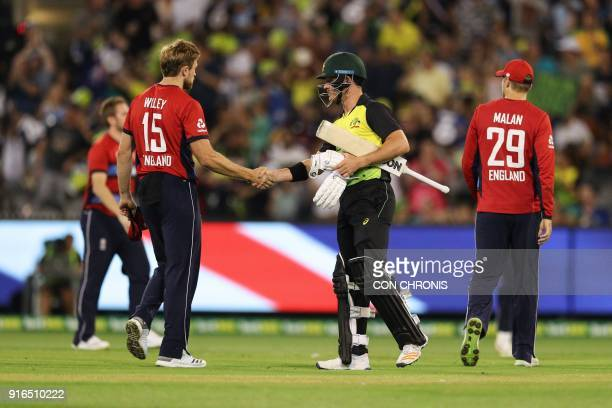 Australia's D'Arcy Short congratulates England's David Willey during the Twenty20 International TriSeries cricket match between England and Australia...