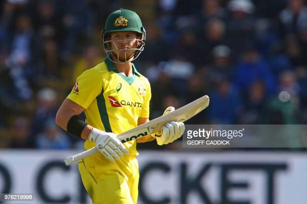 Australia's DArcy Short walks back to the pavilion after losing his wicket for 21 runs during play in the 2nd One Day International cricket match...