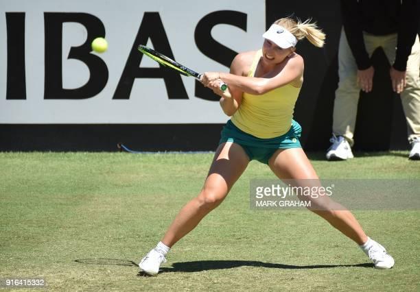 Australia's Daria Gavrilova hits a return against Ukraine's Marta Kostyuk during their women's singles Federation Cup tennis match in Canberra on...