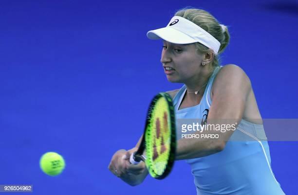 Australia's Daria Gavrilova returns the ball to Ukraine's Lesia Tsurenko during the Mexico WTA Open women's singles semifinal tennis match in...