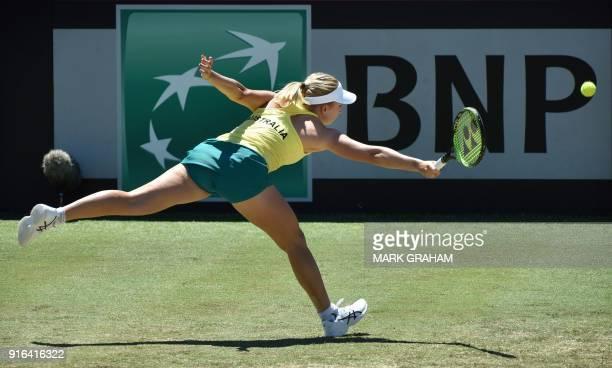 Australia's Daria Gavrilova stretches to try and hit a return against Ukraine's Marta Kostyuk during their women's singles Federation Cup tennis...