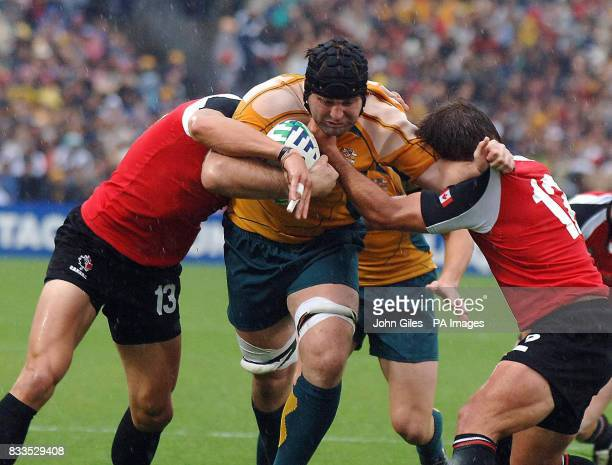 Australia's David Lyons powers through the Canadian defence during the IRB Rugby World Cup Pool B match at Chaban Delmas Stadium Bordeaux France