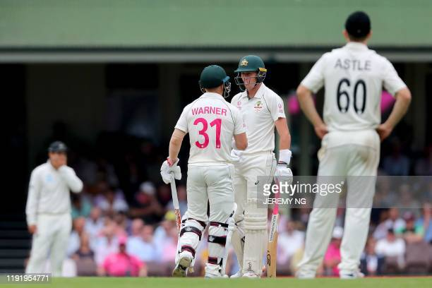 Australia's David Warner and Marnus Labuschagne speak between overs during the fourth day of the third cricket Test match between Australia and New...