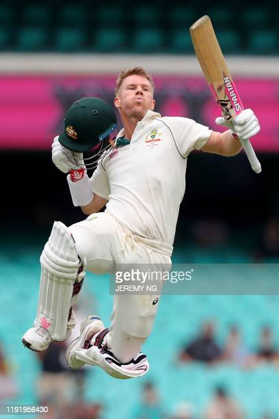 Australia's David Warner celebrates after reaching his century during the fourth day of the third cricket Test match between Australia and New...