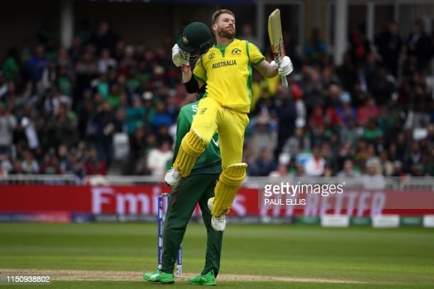 Australia's David Warner celebrates his century during the 2019 Cricket World Cup group stage match between Australia and Bangladesh at Trent Bridge...