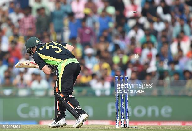 Australia's David Warner is bowled during the World T20 cricket tournament match between Australia and Pakistan at The Punjab Cricket Stadium...