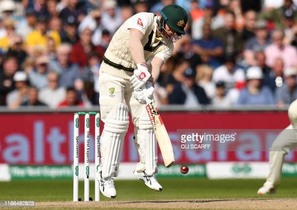 Australia's David Warner loses his wicket for no runs during the fourth day of the fourth Ashes cricket Test match between England and Australia at...