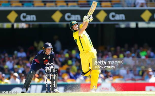 Australia's David Warner plays a shot as England's Jos Buttler looks on during the 2nd oneday international cricket match between England and...