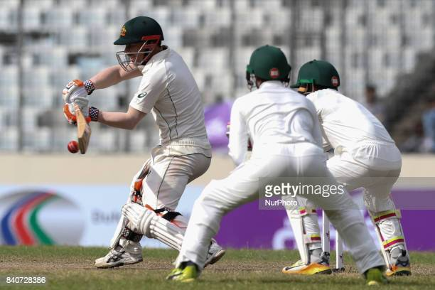 Australia's David Warner plays a shot during day three of the First Test match between Bangladesh and Australia at Shere Bangla National Stadium on...
