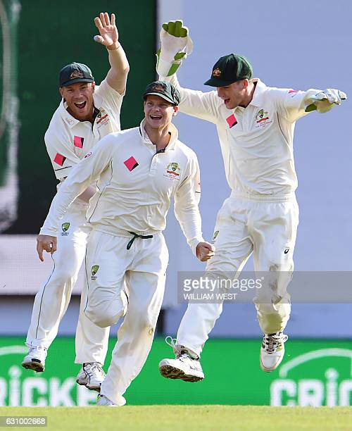 Australia's David Warner Steve Smith and Peter Handscomb celebrate after the dismissal of Pakistan batsman Sarfraz Ahmed during the third day of the...