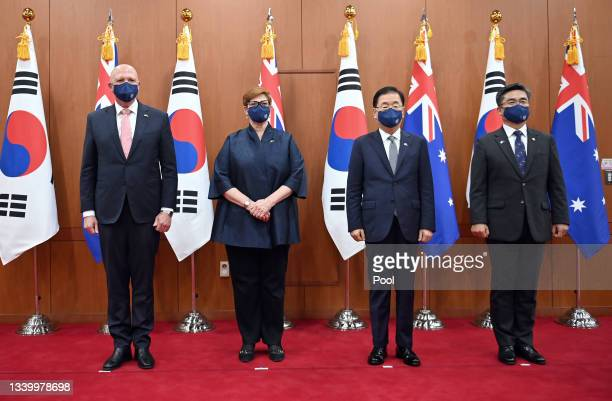Australia's Defence Minister Peter Dutton and Foreign Minister Marise Payne pose with South Korea's Foreign Minister Chung Eui-yong and Defence...