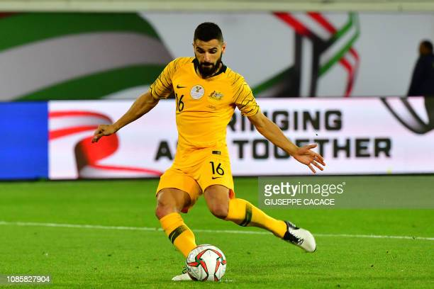 Australia's defender Aziz Behich takes a penalty during the 2019 AFC Asian Cup Round of 16 football match between Australia and Uzbekistan at the...