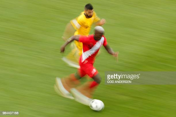 Australia's defender Aziz Behich vies for the ball with Peru's defender Luis Advincula during the Russia 2018 World Cup Group C football match...