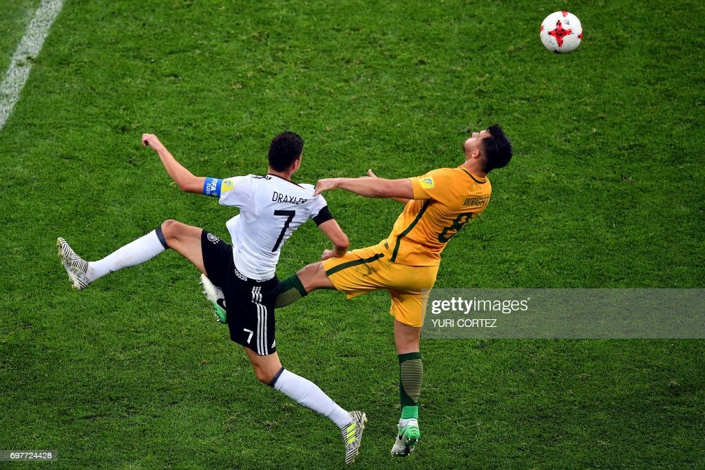 TOPSHOT - Australia's defender Bailey Wright (L) challenges Germany's midfielder Julian Draxler during the 2017 Confederations Cup group B football match between Australia and Germany at the Fisht Stadium in Sochi on June 19, 2017. / AFP PHOTO / Yuri CORTEZ