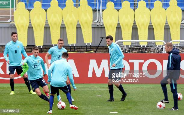 LR Australia's defender Dylan McGowan midfielder Ajdin Hrustic defender Bradley Smith and Australia's defender Ryan McGowan take part in a training...