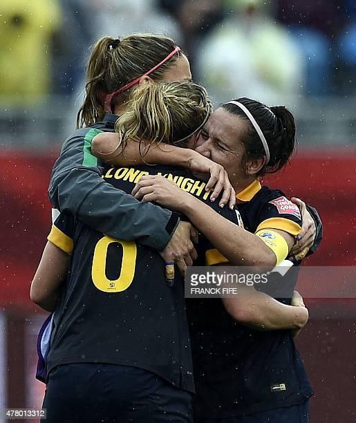 Australia's defender Elise KellondKnight and Australia's midfielder Emily Van Egmond celebrate his victory against Brazil during their 2015 FIFA...