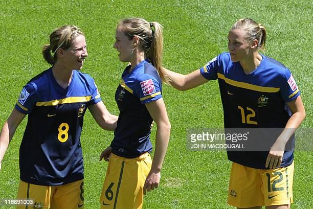 Australia's defender Ellyse Perry is congratulated by her teammates Australia's defender Elise KellondKnight and Australia's midfielder Emily van...