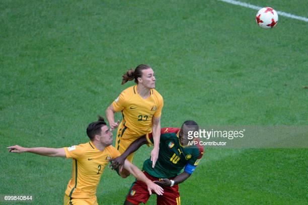 TOPSHOT Australia's defender Milos Degenek jumps for the ball along with Australia's midfielder Jackson Irvine and Cameroon's forward Vincent...