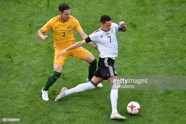 TOPSHOT Australia's defender Milos Degenek vies for the ball against Germany's midfielder Julian Draxler during the 2017 Confederations Cup group B...