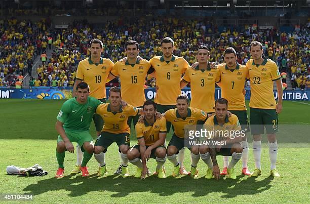 Australia's defender Ryan McGowan Australia's midfielder Mile Jedinak Australia's defender Matthew Spiranovic Australia's defender Jason Davidson...