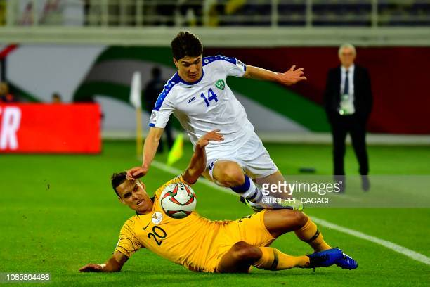 Australia's defender Trent Sainsbury vies for the ball with Uzbekistan's forward Eldor Shomurodov during the 2019 AFC Asian Cup Round of 16 football...