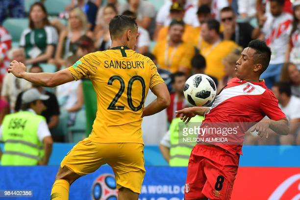 Australia's defender Trent Sainsbury vies for the ball with Peru's midfielder Christian Cueva during the Russia 2018 World Cup Group C football match...