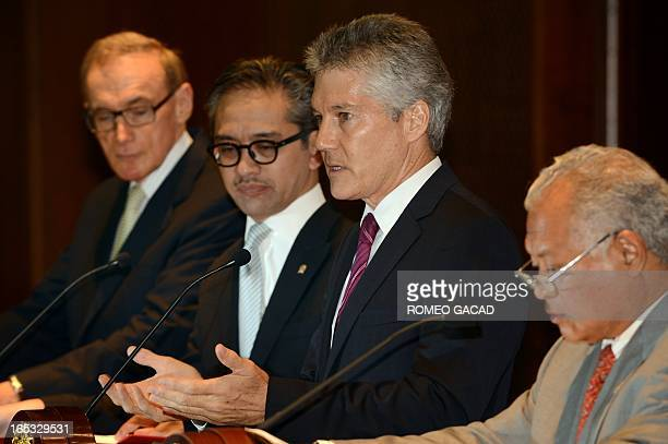 Australia's Defense Minister Stephen Smith delivers his address as Foreign Minister Bob Carr and Indonesia's Foreign Minister Marty Natalegawa and...