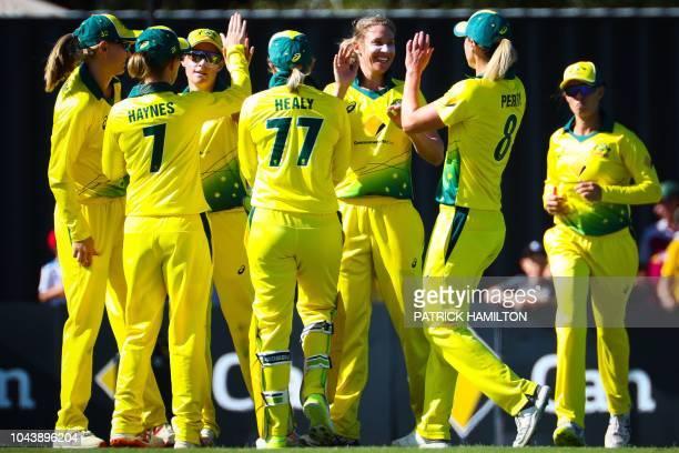 Australia's Delissa Kimmince dismisses New Zealand's captain Amy Satterthwaite during the women's T20 cricket match between Australia and New Zealand...