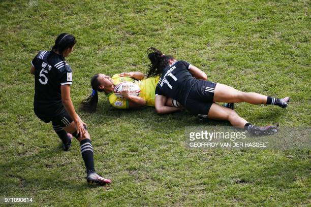 Australia's Demi Hayes is tackled by New Zealand's Portia Woodman during the final of the Women's tournament of 2018 Rugby World Cup Sevens game...