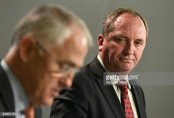 Australia's Deputy Prime Minister Barnaby Joyce looks at Prime Minister Malcolm Turnbull addressing a press conference in Sydney on July 5 2016 after...