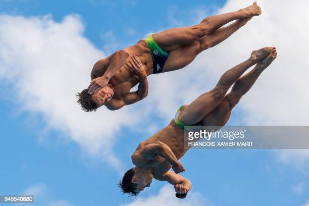 Australia's Dominic Bedggoog and Australia's Declan Stacey compete during the men's synchronised 10m platform diving final during the 2018 Gold Coast...