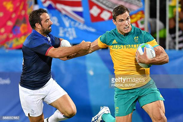 Australia's Ed Jenkins scores a try in the mens rugby sevens match between France and Australia during the Rio 2016 Olympic Games at Deodoro Stadium...