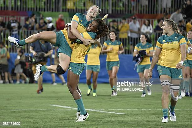 Australia's Ellia Green lifts up a teammate as they celebrate victory in the womens rugby sevens gold medal match between New Zealand and Australia...