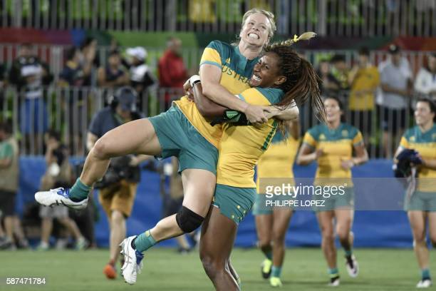TOPSHOT Australia's Ellia Green lifts up a teammate as they celebrate victory in the womens rugby sevens gold medal match between New Zealand and...