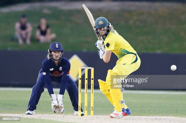 Australia's Ellyse Perry hits a six as England's Sarah Taylor looks on during the Women's One Day International match between Australia and England...