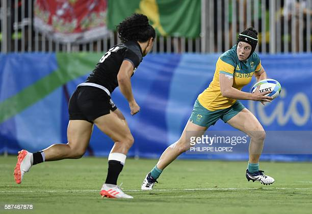 Australia's Emilee Cherry runs with the ball in the womens rugby sevens gold medal match between New Zealand and Australia during the Rio 2016...