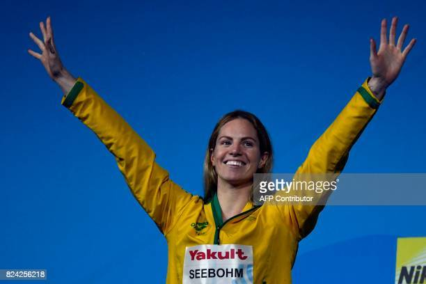 Australia's Emily Seebohm celebrates on the podium after the women's 200m backstroke final during the swimming competition at the 2017 FINA World...