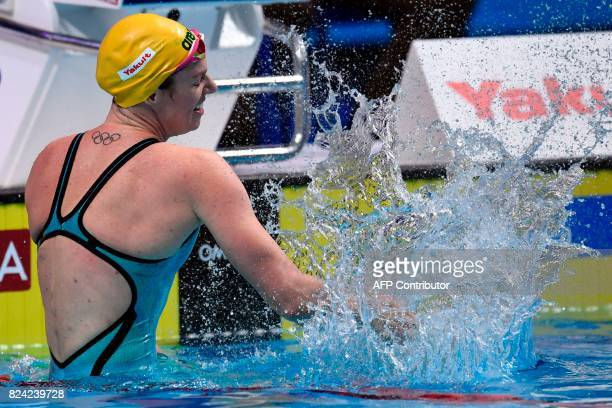 Australia's Emily Seebohm reacts after competing in the women's 200m backstroke final during the swimming competition at the 2017 FINA World...