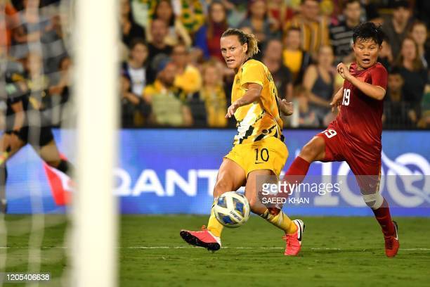 Australia's Emily van Egmond and Vietnam's Nguyen Thi Bich Thuy fight for the ball during the women's Olympic football tournament qualifier match...