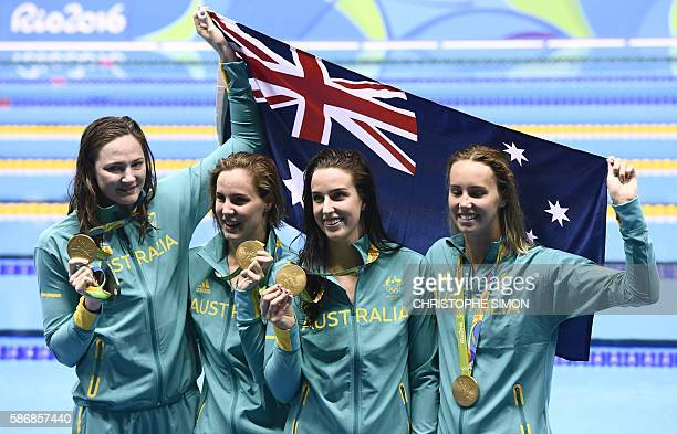 Australia's Emma Mckeon Australia's Brittany Elmslie Australia's Bronte Campbell and Australia's Cate Campbell pose with their gold medals on the...