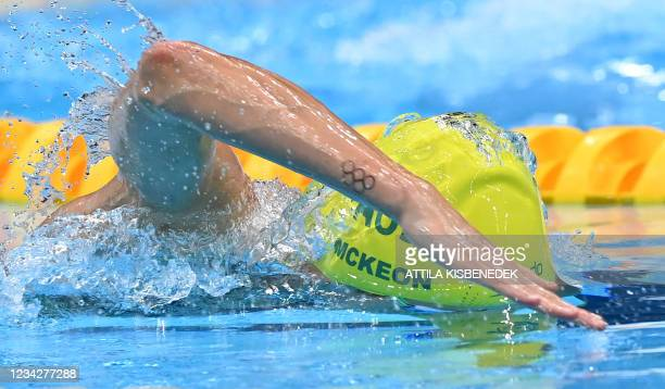 Australia's Emma McKeon competes to win a semi-final of the women's 100m freestyle swimming event during the Tokyo 2020 Olympic Games at the Tokyo...
